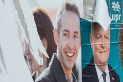torn posters of political party leaders ones of the candidates running in the May 2019 european elections royalty free stock images