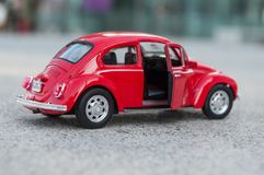 Closeup of vintage red miniature volkswagen bettle in the street. Mulhouse - France - 17 October 2018 - closeup of vintage red miniature volkswagen bettle in the stock photography