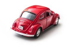 Closeup of vintage red miniature volkswagen bettle on white background. Mulhouse - France - 16 October 2018 - closeup of vintage red miniature volkswagen bettle royalty free stock photos