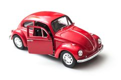 Closeup of vintage red miniature volkswagen bettle on white background. Mulhouse - France - 16 October 2018 - closeup of vintage red miniature volkswagen bettle stock photography