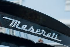 Retail of maserati granturismo logo on black sport car parked in the street Stock Image