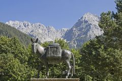 Muli monument in Mittenwald and Karwendel mountains. Muli monument in Mittenwald - robust and lively means of transport in the mountains stock image