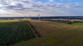 Mulini a vento al tramonto fotografia stock libera da diritti