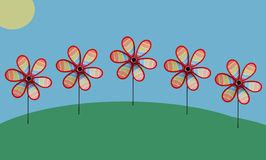 Mulini a vento capricciosi su paesaggio Fotografia Stock