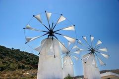 Mulini a vento in crete Immagini Stock