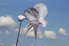 Mulini a vento del panno con cielo blu Fotografia Stock