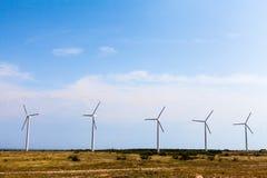 Mulini a vento il giorno soleggiato Fotografie Stock