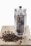 Mulino di vetro con peperone dolce nero, bianco e rosso Immagini Stock