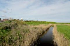 Mulino a vento al Cley-seguente--mare, Norfolk immagine stock