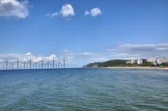 Mulino a vento al litorale di mare Immagine Stock Libera da Diritti