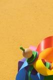 Mulino a vento colorato su colore giallo Immagini Stock Libere da Diritti