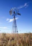 Mulino a vento con aumentare del sole Fotografie Stock