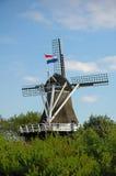 Mulino a vento con la bandierina Fotografia Stock
