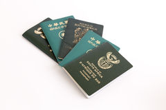 Muliple passports on white background Royalty Free Stock Image