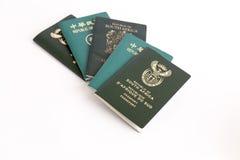 Muliple passports on white background Stock Photo