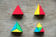 Mulit color toy block compound as triangle shape. On wood background Stock Photography