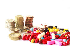 Muliti color pills and money Royalty Free Stock Photos