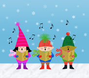 Muliticultural Children Carolers. Multicultural children singing Christmas carols in the snow Stock Images