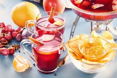 Mull. Glasses with mulled wine, punch or grog with fruit and cornflakes. Hot winter wine Royalty Free Stock Images