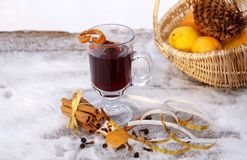 Mulled red wine on a snowy table outdoor in winter Royalty Free Stock Images