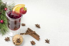 Mulled red wine with spicies, schoko cookies and pine branch royalty free stock photo