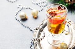 Mulled white wine with grapefruit Christmas, New Year background. Mulled white wine with grapefruit and spices in a glass on a Christmas, New Year background Stock Photos