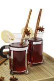 Mulled wine. Two glasses of mulled wine with spices on wooden tray. Isolated on white background Royalty Free Stock Photos
