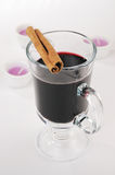 Mulled wine. In the glass and cinnamon on white background Stock Image