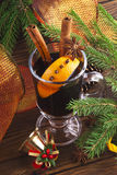 Mulled wine. Hot spiced mulled wine garnished with orange Royalty Free Stock Images
