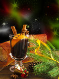 Mulled wine. Hot spiced mulled wine garnished with orange Royalty Free Stock Photo