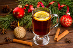 Mulled wine with anise and christmas ball Stock Images