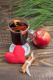 Mulled wine with apple and cinnamon and handmade soft red hearts. Christmas holidays Royalty Free Stock Image