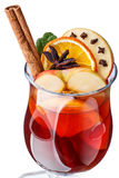Mulled wine with apples. Decorated with cinnamon stick, star anise, cloves and cowberry leaves Stock Image
