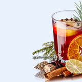 Mulled wine with apples. Decorated with cloves and pine branch Stock Photo