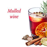 Mulled wine with apples. Decorated with cloves and pine branch Royalty Free Stock Photos
