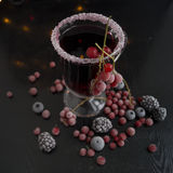 Mulled wine. Mulled wine with berries on a black background.n Stock Photography