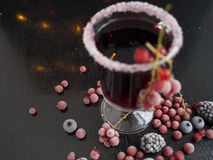 Mulled wine. Mulled wine with berries on a black background.n Royalty Free Stock Photos