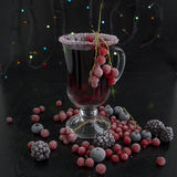 Mulled wine. Mulled wine with berries on a black background.n Stock Images