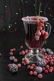Mulled wine. Mulled wine with berries on a black background.n Stock Image