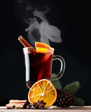 Mulled wine, blue pine tree branch and spices Stock Photo