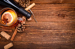 Mulled wine. Bottle of red wine, corkscrew and corks on  wooden table. Christmas Royalty Free Stock Photos