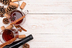 Mulled wine. A bottle of red wine on a white wooden table. Christmas Royalty Free Stock Photo