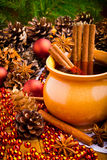 Mulled wine in brown jug Stock Images