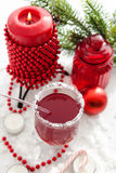 Mulled wine and candle with Christmas decorations around Stock Photo