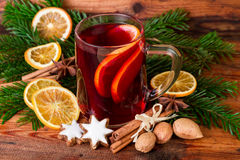 Mulled wine with christmas decoration on dark wooden stock images