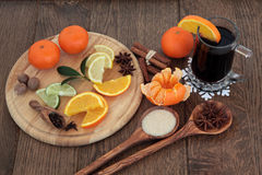 Mulled Wine. Christmas mulled wine ingredients of citrus fruit and spices over oak background Royalty Free Stock Photography