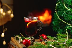 Mulled wine  with Christmas ornaments. Mulled wine on a wooden tray with Christmas ornaments Royalty Free Stock Photos