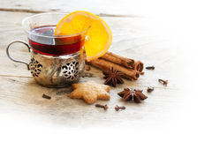 Mulled wine, Christmas punch with orange slice and spices on rus Stock Photo