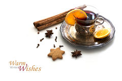 Mulled wine, Christmas punch with orange slices and spices isola Royalty Free Stock Photography