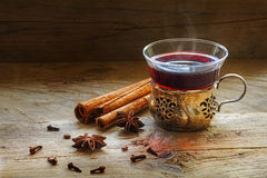 Mulled wine, Christmas punch with spices on rustic wood Stock Image